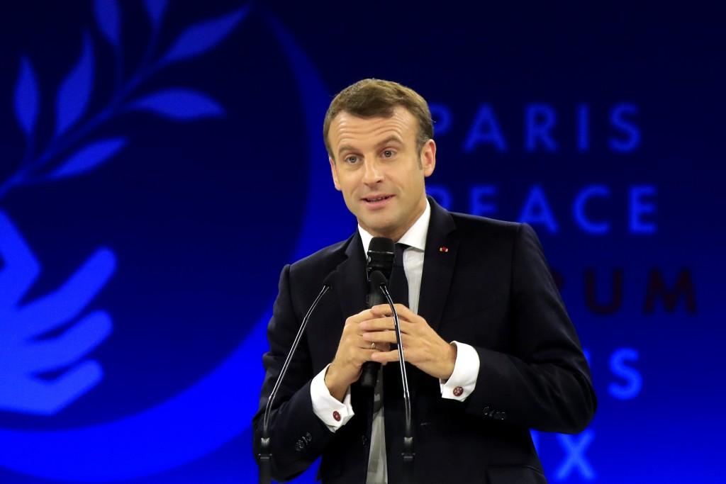 French President Emmanuel Macron delivers his speech at the Paris Peace Forum Tuesday, Nov. 12, 2019 in Paris. (AP Photo/Michel Euler, Pool)