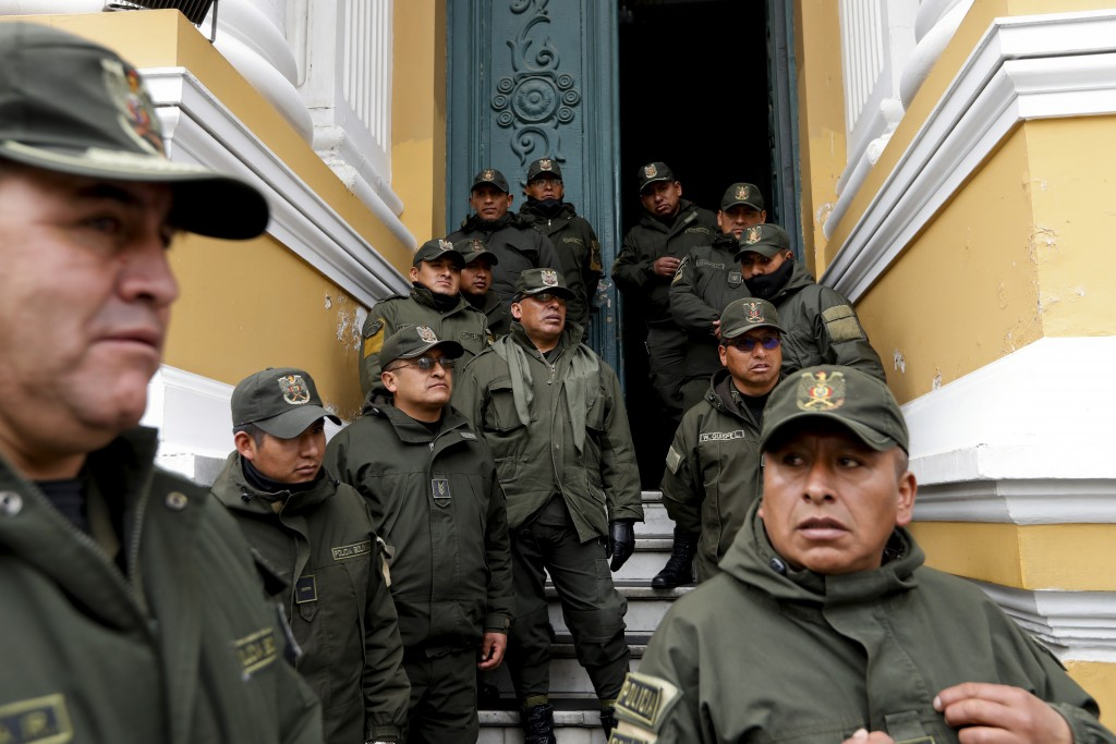 Police guard Congress in La Paz, Bolivia, Monday, Nov. 11, 2019. Bolivian President Evo Morales' Nov. 10 resignation, under mounting pressure from the...