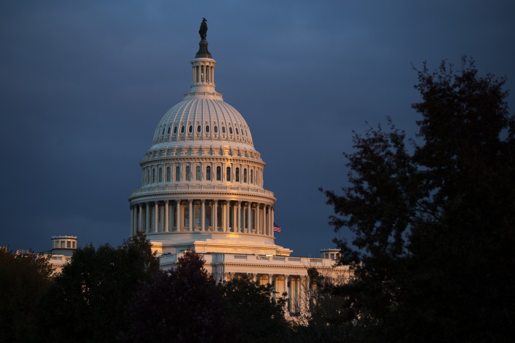 The U.S. Capitol is seen as the sun sets, Tuesday, Nov. 12, 2019, in Washington. The public impeachment inquiry hearings set to begin Wednesday will p...