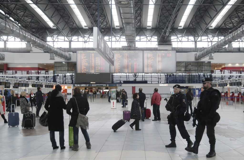 FILE - In this file photo dated March 22, 2016, police officers patrol the Vaclav Havel Airport in Prague, Czech Republic. On Wednesday Nov. 13, 2019,...