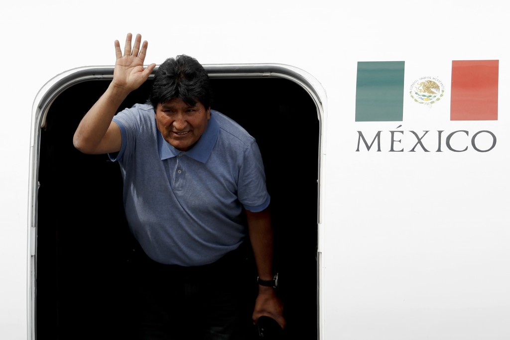Former Bolivian President Evo Morales waves upon arrival to Mexico City, Tuesday, Nov. 12, 2019. Mexico granted asylum to Morales, who resigned on Nov...