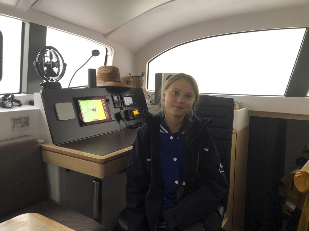 Greta Thunberg, a 16-year-old climate activist from Sweden, sits on a catamaran docked in Hampton, Va., on Tuesday, Nov. 12, 2019. Thunberg will leave...