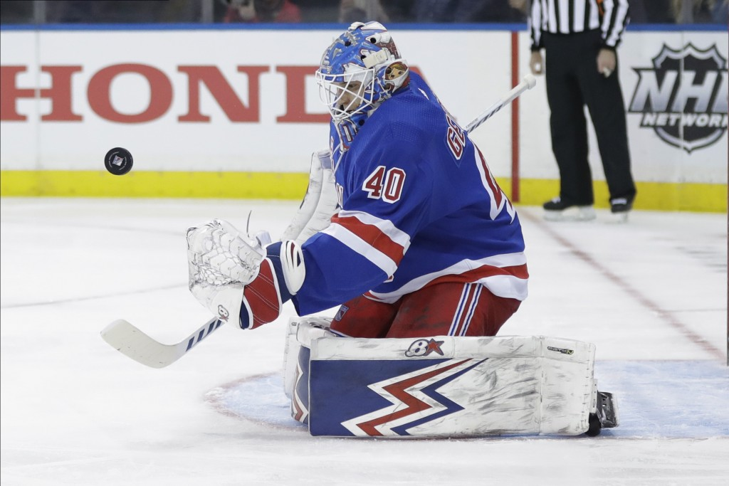 New York Rangers goaltender Alexandar Georgiev (40) stops a shot on goal by during the first period of an NHL hockey game against the Pittsburgh Pengu...
