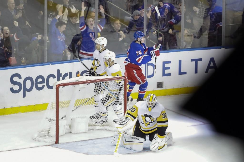 Pittsburgh Penguins goaltender Matt Murray (30) reacts as New York Rangers' Kaapo Kakko (24) celebrates after scoring the game winning goal during ove...