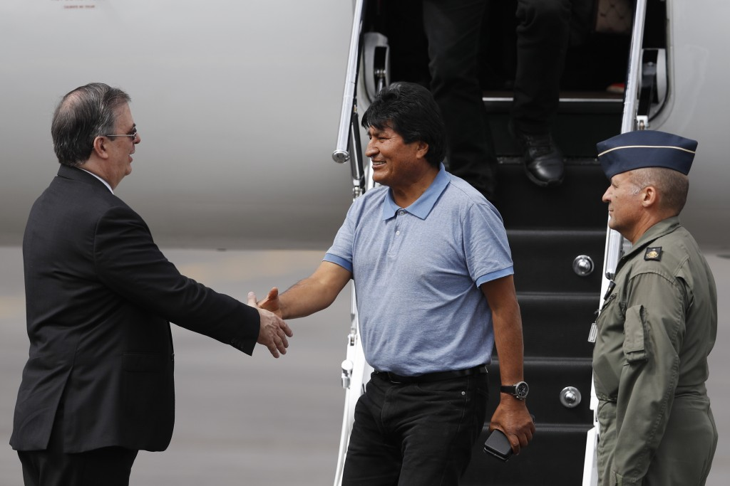 Mexican Foreign Minister Marcelo Ebrard, left, welcomes former Bolivian President Evo Morales in Mexico City, Tuesday, Nov. 12, 2019. Mexico granted a...