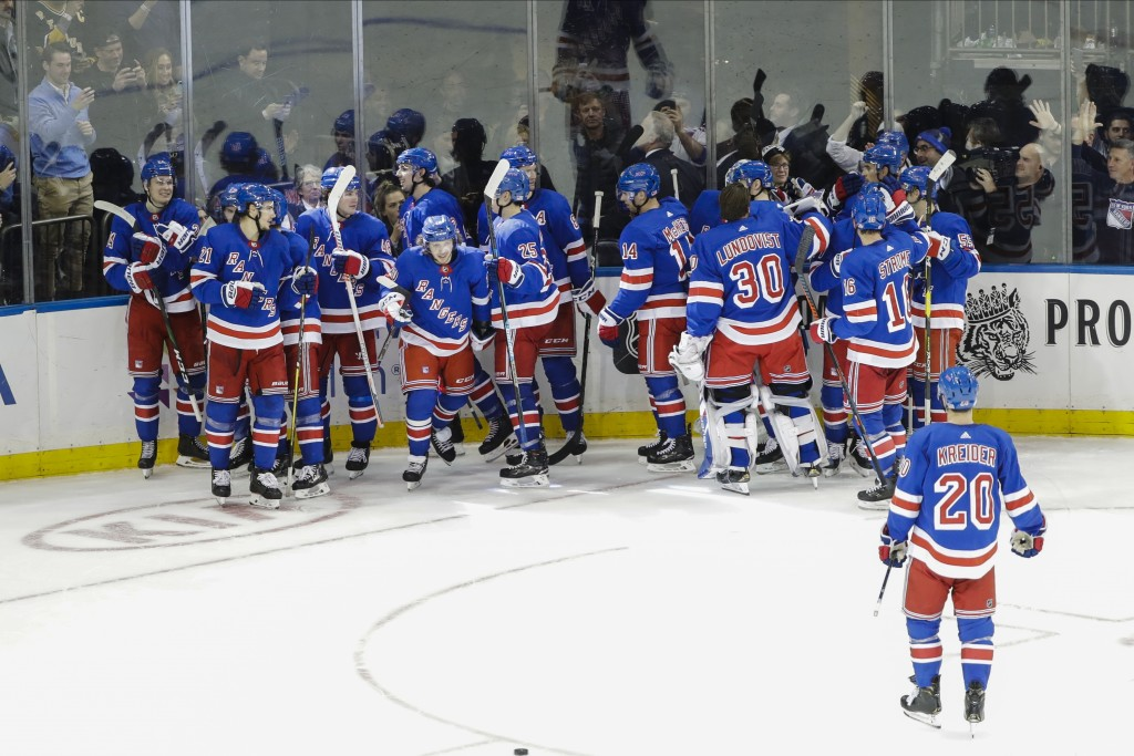 The New York Rangers celebrate after an NHL hockey game against the Pittsburgh Penguins Tuesday, Nov. 12, 2019, in New York. The Rangers won 3-2 in ov...