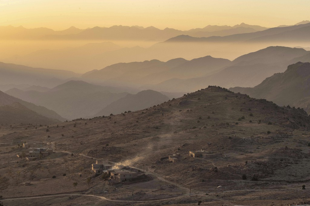 In this Monday, Nov. 4, 2019 photo, the sun sets behind Saffron-rich Askaoun, a small village near the town of Taliouine in Morocco's Middle Atlas Mou...