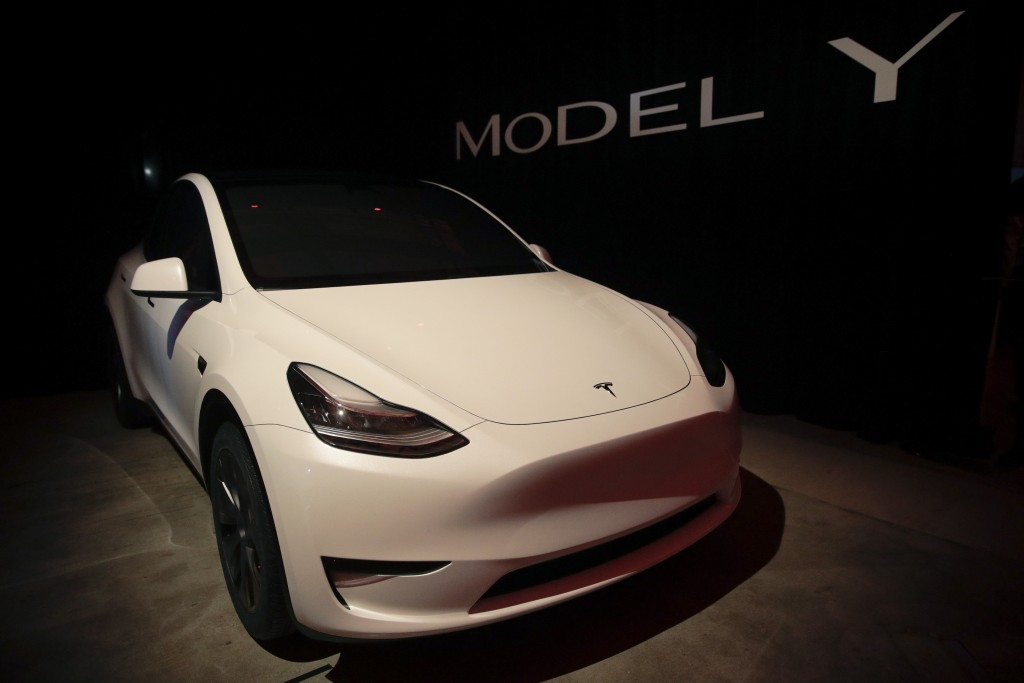 FILE- In this March 14, 2019, file photo Tesla's Model Y is displayed at Tesla's design studio in Hawthorne, Calif. Tesla CEO Elon Musk says the elect...