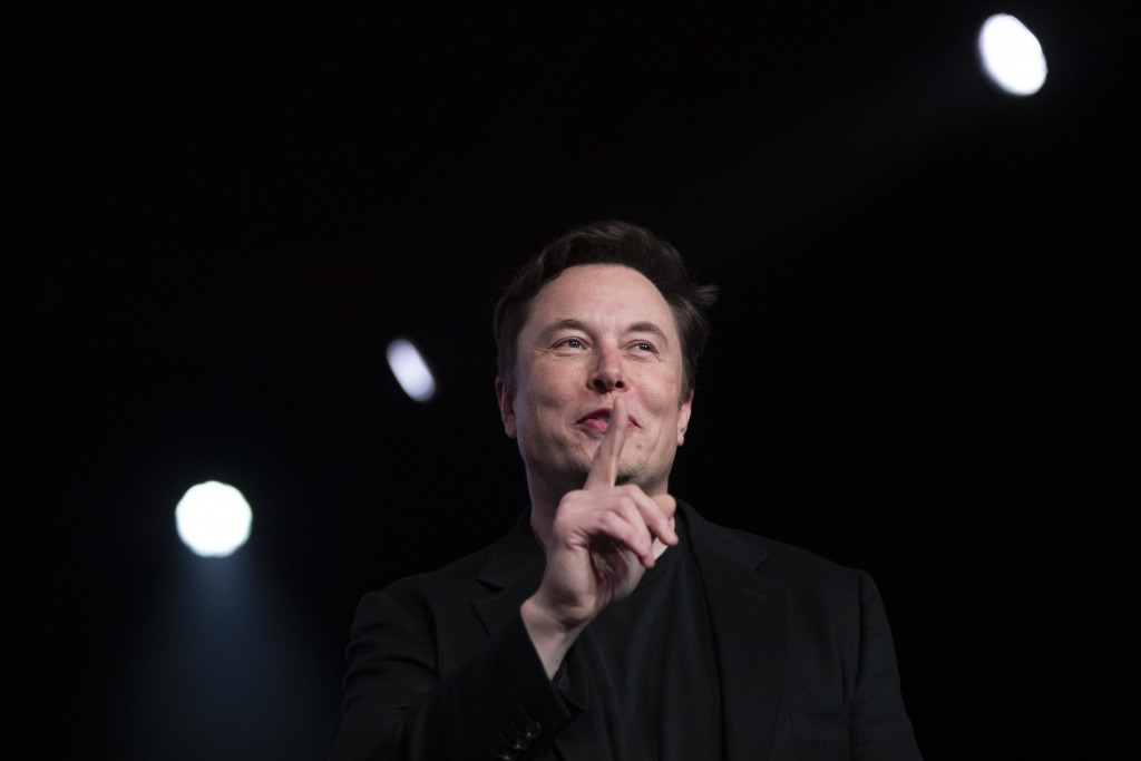 FILE- In this March 14, 2019, file photo Tesla CEO Elon Musk speaks before unveiling the Model Y at Tesla's design studio in Hawthorne, Calif. Musk is...