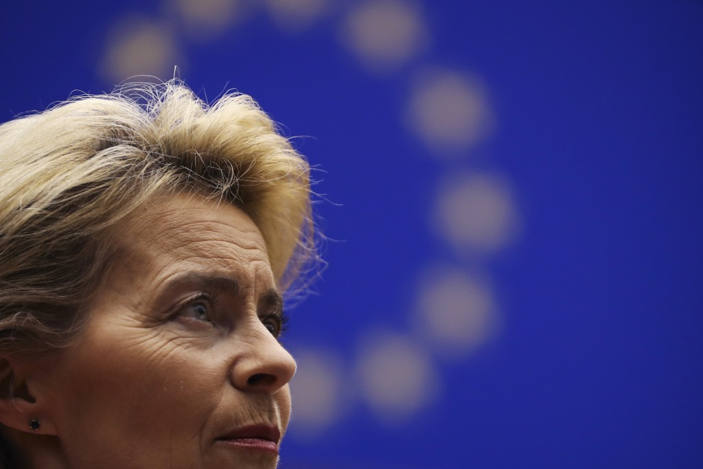 Incoming European Commission President Ursula von der Leyen talks to European Commission Vice-President Frans Timmermans prior a ceremony to mark the ...