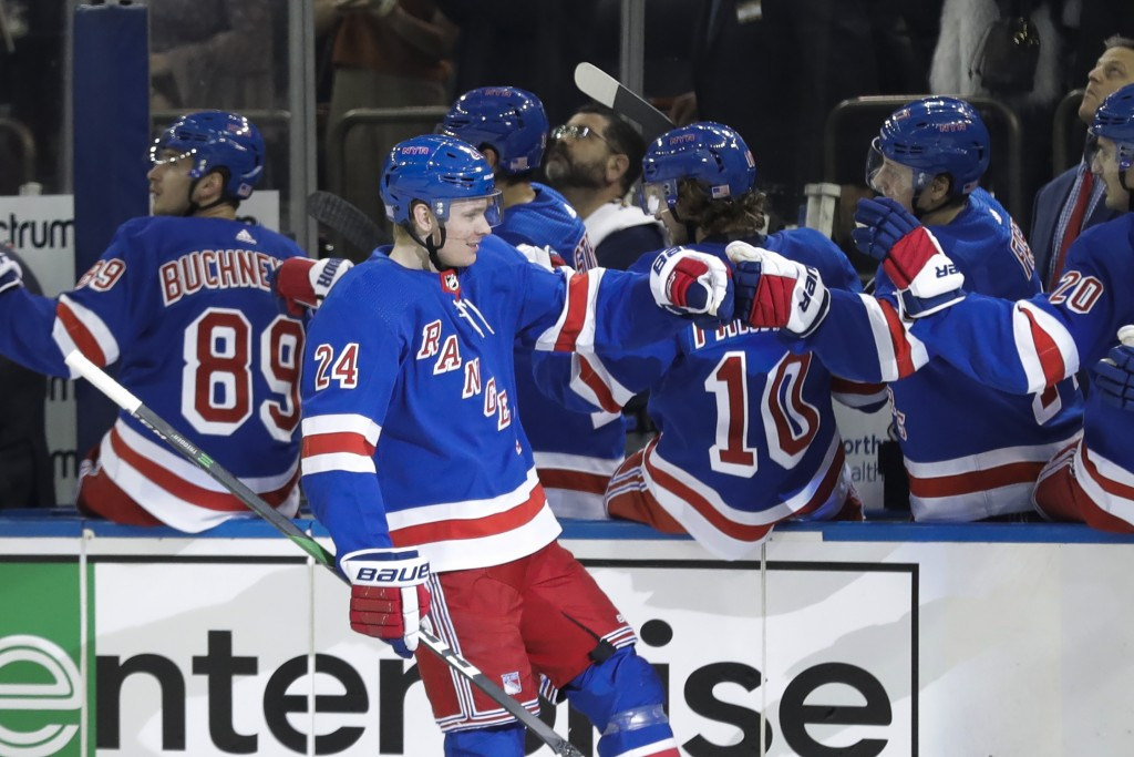New York Rangers' Kaapo Kakko (24) celebrates with teammates after scoring a goal during the first period of an NHL hockey game against the Pittsburgh...