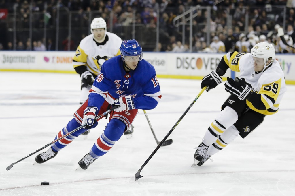 New York Rangers' Ryan Strome (16) drives past Pittsburgh Penguins' Jake Guentzel (59) during the second period of an NHL hockey game Tuesday, Nov. 12...