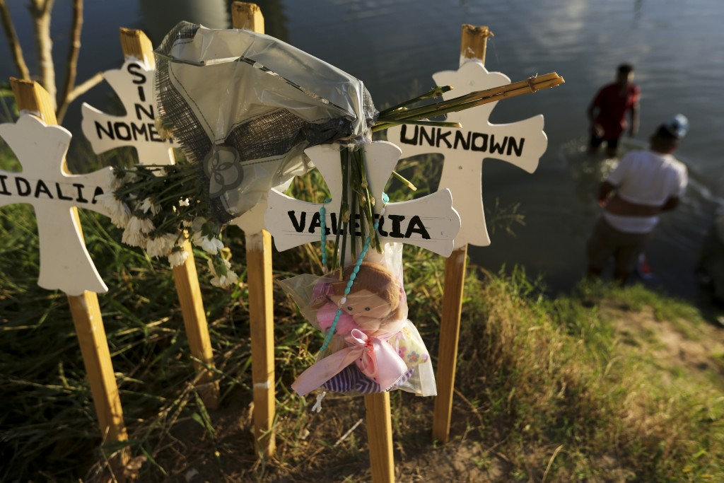 ADVANCE FOR USE SUNDAY, NOV. 17, 2019 AND THEREAFTER- In this Oct. 11, 2019 photo, crosses covered with the names of people who have drowned trying to...