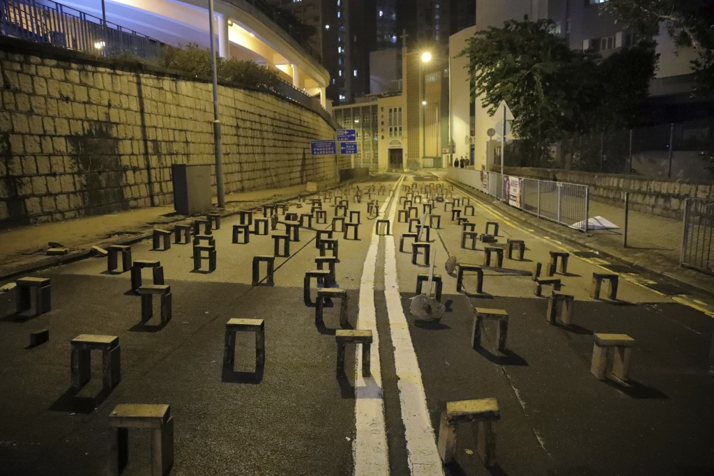 Bricks are set by pro-democracy protesters outside the campus of the University of Hong Kong, early Thursday, Nov. 14, 2019. University students from ...