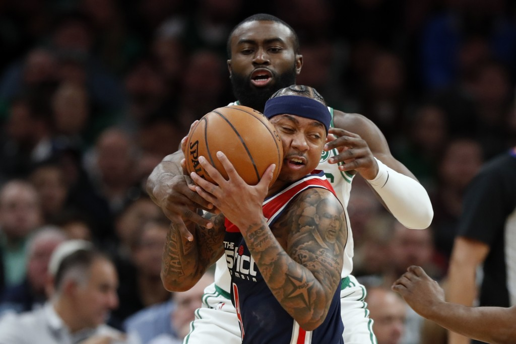 Boston Celtics' Jaylen Brown, rear, tries to steal the ball from Washington Wizards' Isaiah Thomas during the first quarter of an NBA basketball game ...
