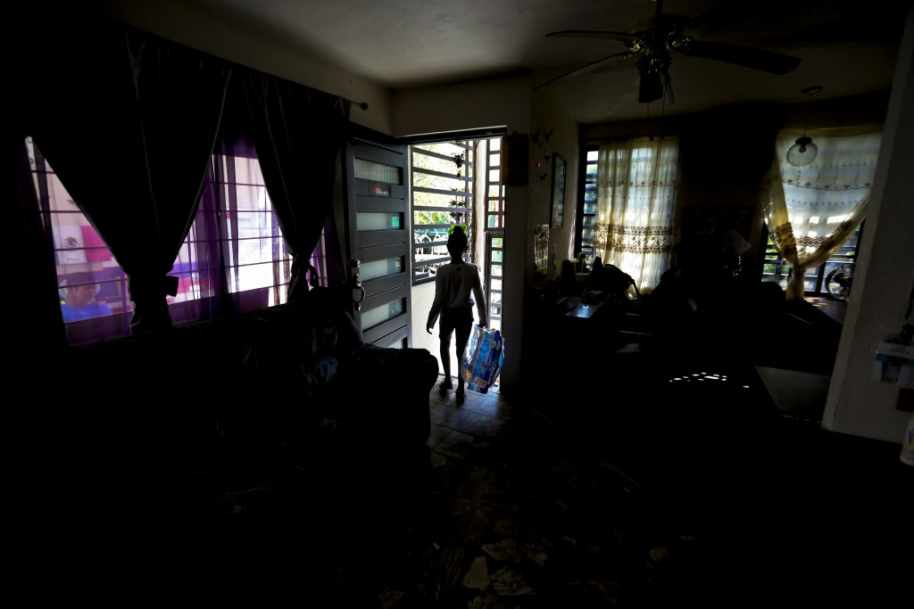 ADVANCE FOR USE SUNDAY, NOV. 17, 2019 AND THEREAFTER- In this Sept. 18, 2019 photo, the 10-years-old daughter of Yohan, a Nicaraguan security guard, h...