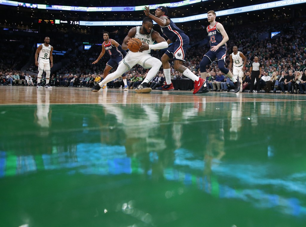 Boston Celtics' Jaylen Brown tries to get past Washington Wizards' Bradley Beal during the second quarter of an NBA basketball game Wednesday, Nov. 13...