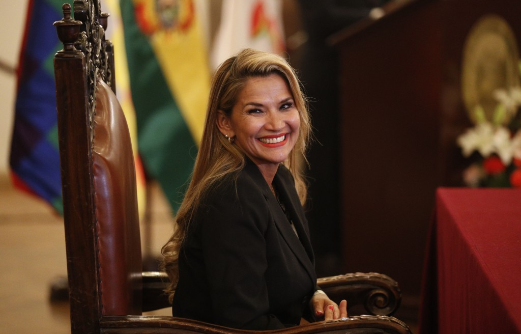 The opposition senator who has claimed Bolivia's presidency Jeanine Anez smiles during the swearing-in ceremony of her new cabinet at the presidential...
