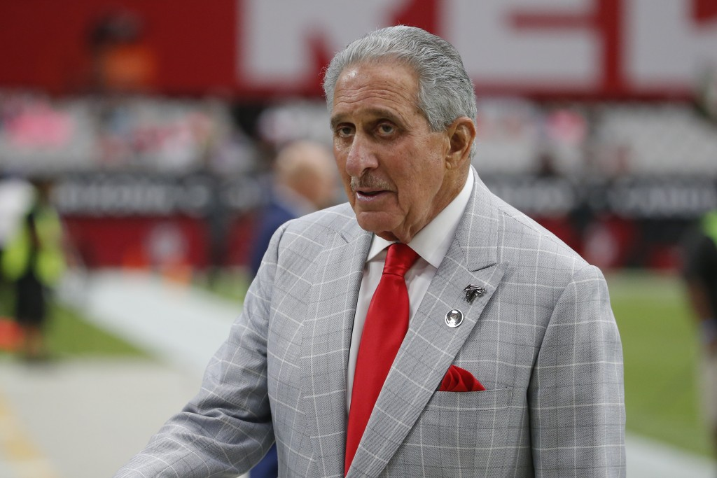 FILE - In this Oct. 13, 2019, file photo, Atlanta Falcons owner Arthur Blank stands on the field prior to an NFL football game against the Arizona Car...