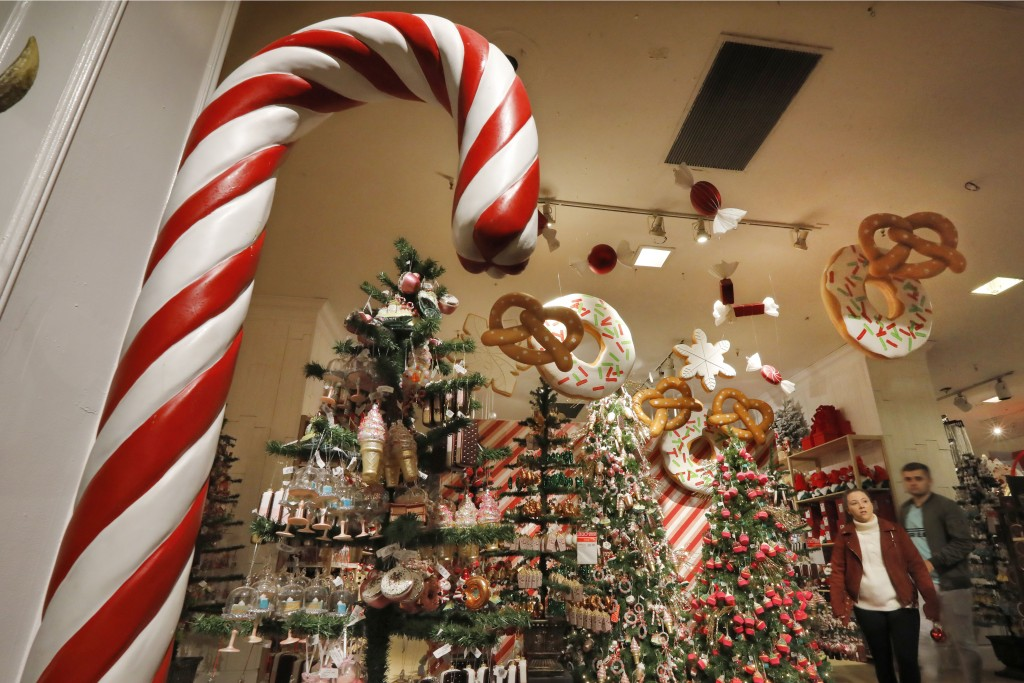 In this Tuesday, Nov. 5, 2019, photo shoppers browse the food-themed decorations in the Holiday Lane section at the Macy's flagship store, in New York...