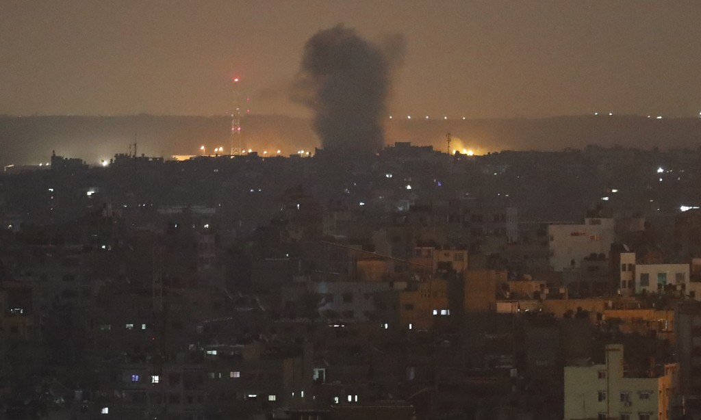 An explosion caused by Israeli airstrikes is seen in Gaza City, early Thursday, Nov. 14, 2019. Israeli aircraft struck Islamic Jihad targets throughou...