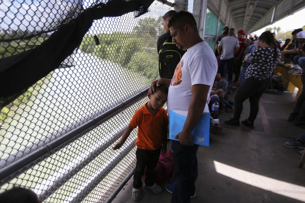 ADVANCE FOR USE SUNDAY, NOV. 17, 2019 AND THEREAFTER- In this Oct. 10, 2019 photo, migrants wait for U.S. authorities to reopen a legal port of entry ...