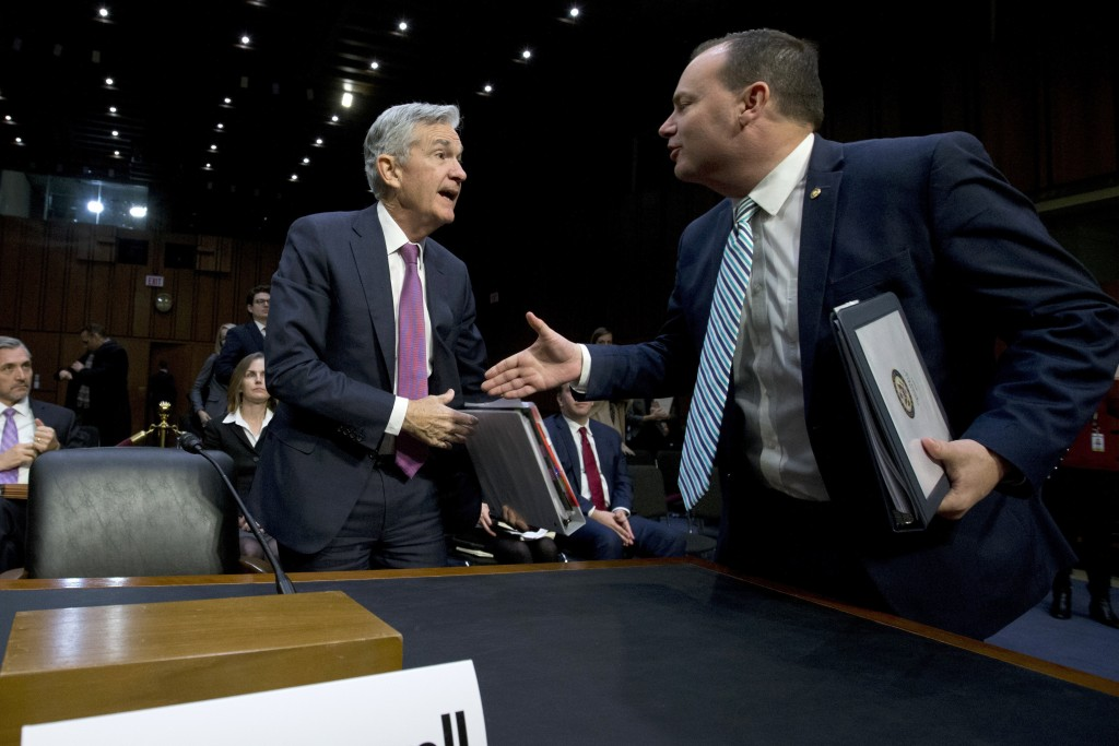 Federal Reserve Board Chair Jerome Powell shake hands with Chairman of the Congress Joint Economic Committee Sen. Mike Lee, R-Utah, during the hearing...