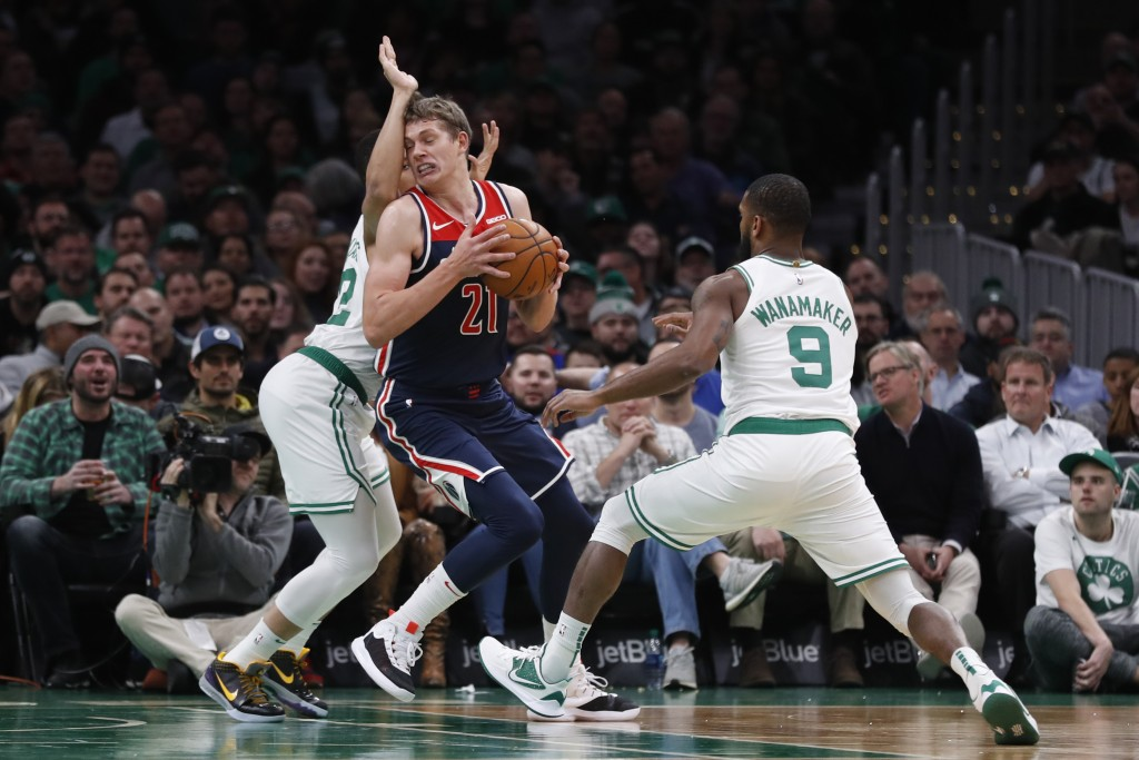 Washington Wizards' Moritz Wagner tries to get between Boston Celtics' Brad Wanamaker (9) and Grant Williams during the second quarter of an NBA baske...