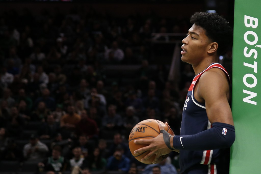 Washington Wizards' Rui Hachimura holfd the ball after going out of bounds during the second quarter of the team's NBA basketball game against the Bos...