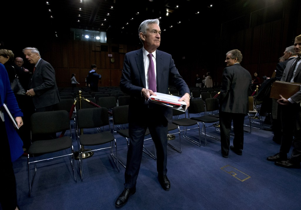 Federal Reserve Board Chair Jerome Powell leaves after the hearing on the economic outlook, on Capitol Hill in Washington, on Wednesday, Nov. 13, 2019...