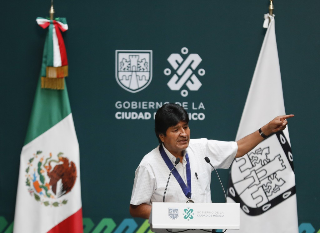 Former Bolivian President Evo Morales delivers his address after he was decorated with a distinguished citizen medal at City Hall in Mexico City, Wedn...