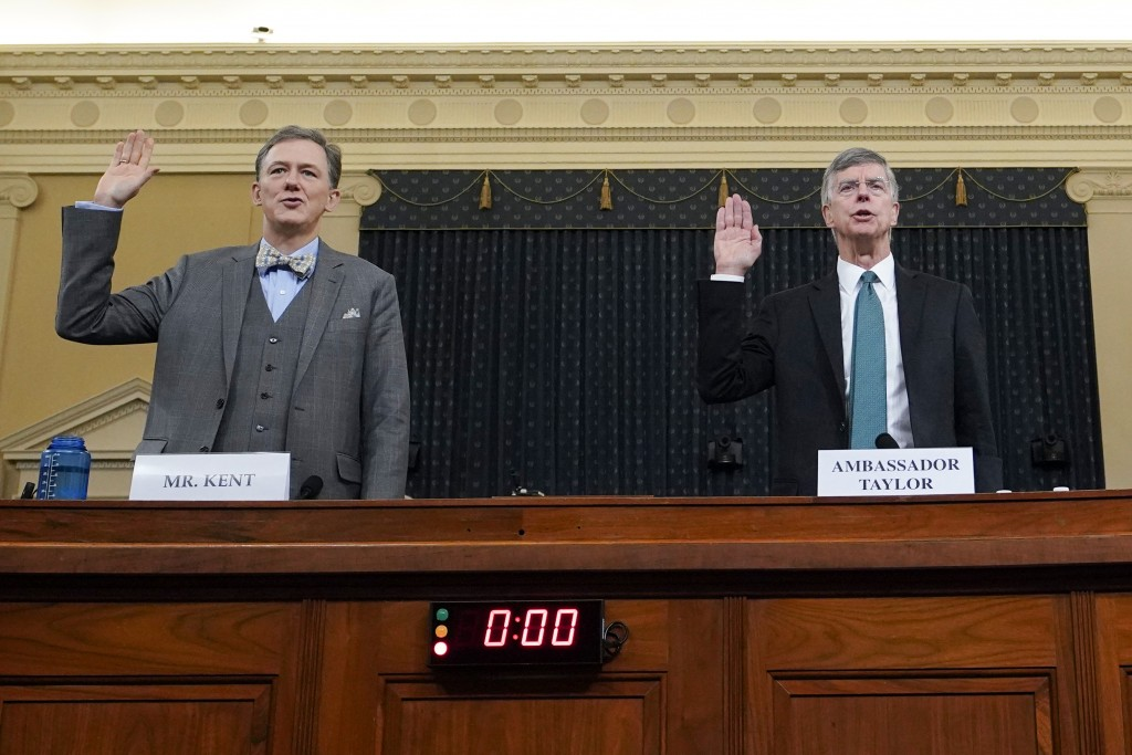 Career Foreign Service officer George Kent and top U.S. diplomat in Ukraine William Taylor, right, are sworn in to testify during the first public imp...