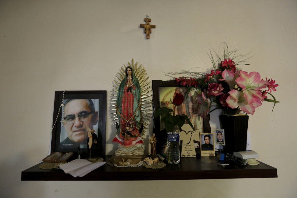 ADVANCE FOR USE SUNDAY, NOV. 17, 2019 AND THEREAFTER- In this Sept. 18, 2019 photo, religious images decorate the kitchen at a migrant shelter in Mont...
