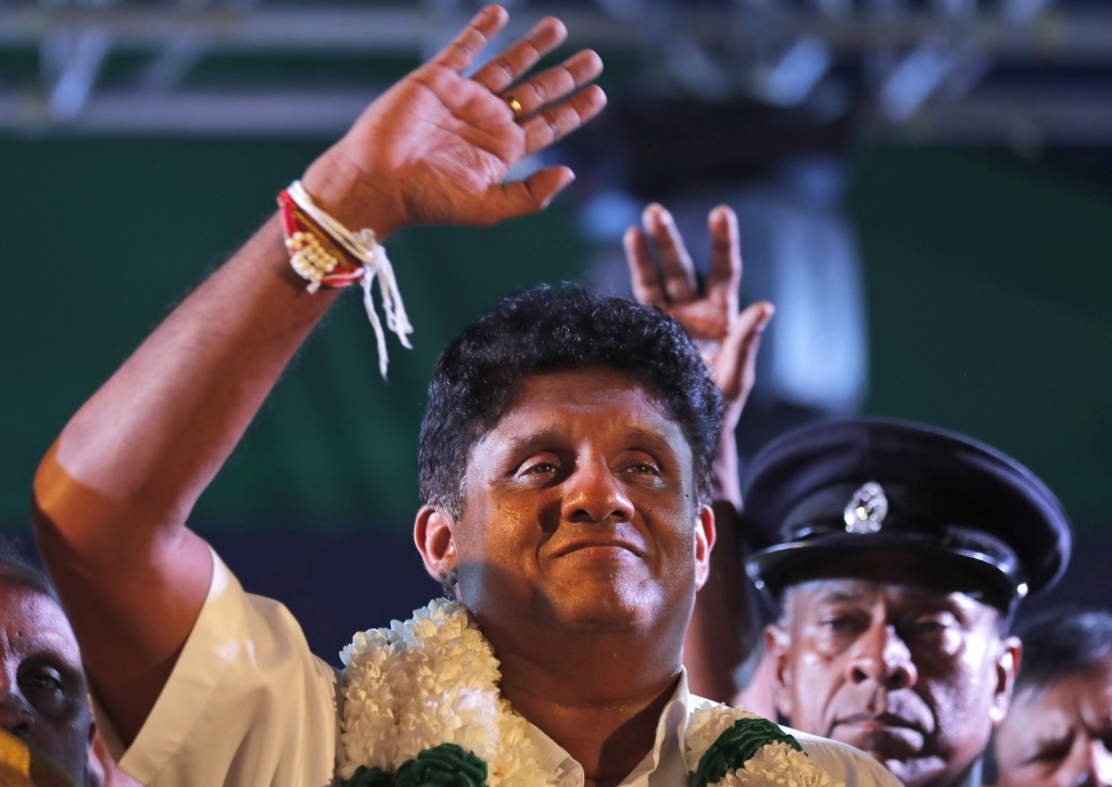 In this Monday, Nov 11, 2019 photo, Sri Lanka's ruling party presidential candidate Sajith Premedasa waves to supporters during a rally in Negombo, Sr...