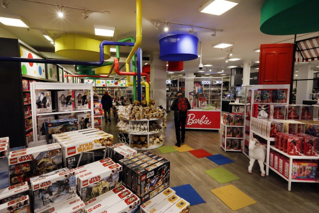 In this Tuesday, Nov. 5, 2019, photo shoppers browse the Fun & Games section at the Macy's flagship store in New York. With three weeks until the offi...