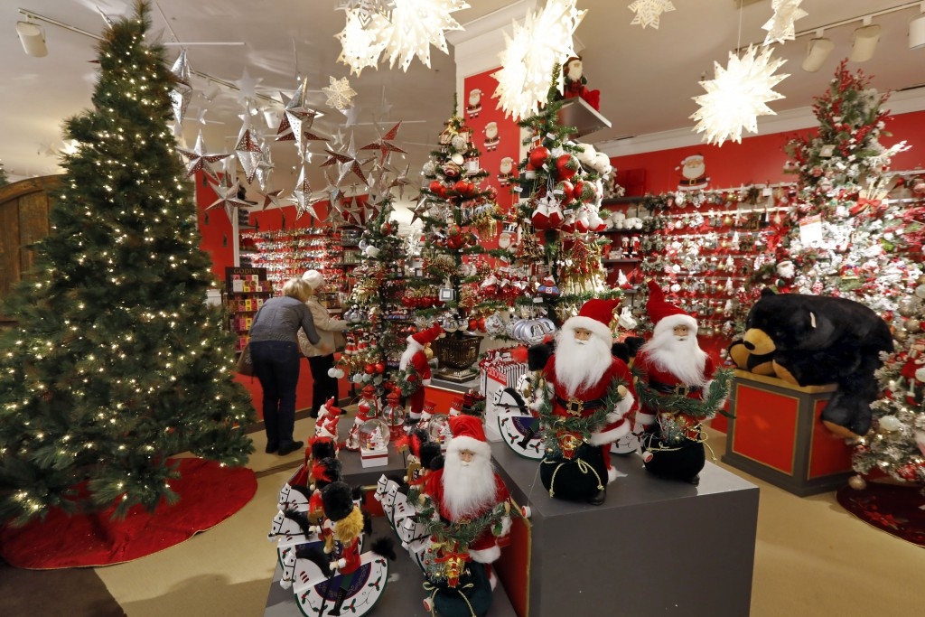 In this Tuesday, Nov. 5, 2019, photo shoppers browse the Holiday Lane section at the Macy's flagship store, in New York. With three weeks until the of...