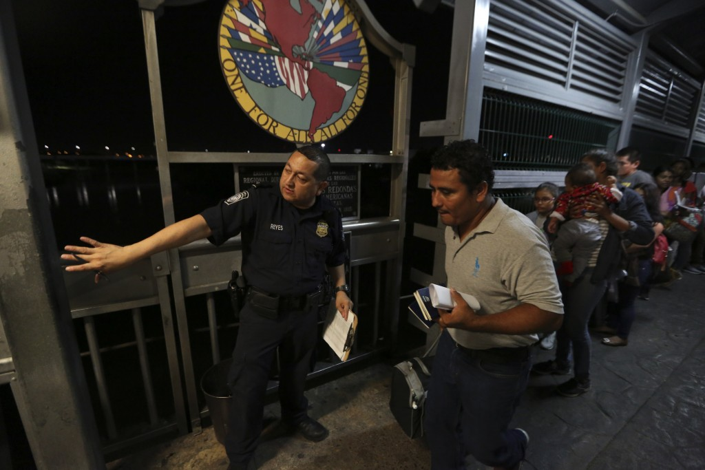ADVANCE FOR USE SUNDAY, NOV. 17, 2019 AND THEREAFTER- In this Sept. 17, 2019 photo, a U.S. border patrol officer directs a Nicaraguan migrant family, ...