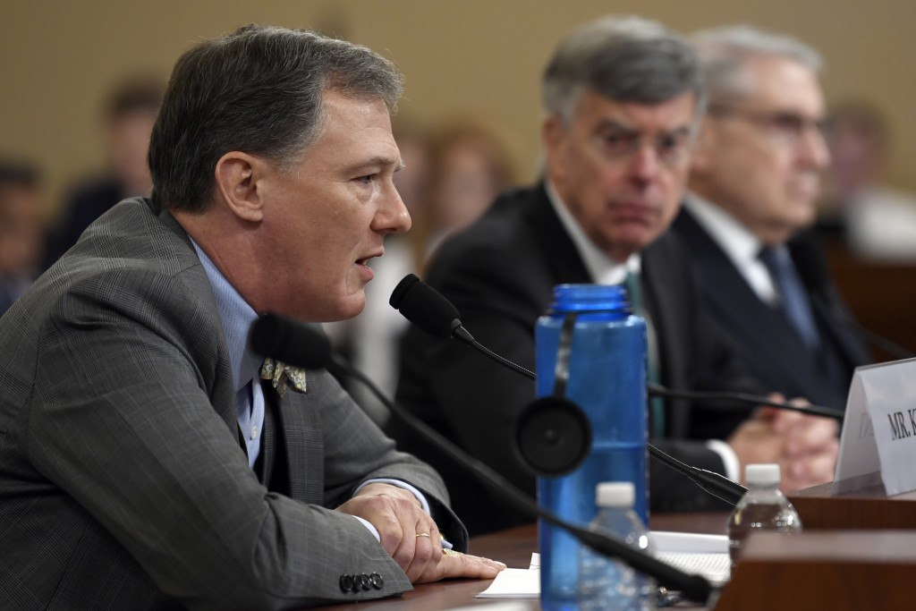 Top U.S. diplomat in Ukraine William Taylor, center, listens as career Foreign Service officer George Kent, testifies before the House Intelligence Co...