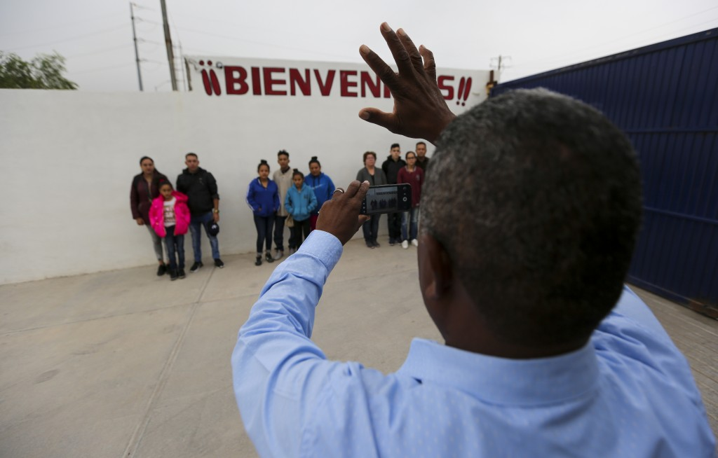 ADVANCE FOR USE SUNDAY, NOV. 17, 2019 AND THEREAFTER- In this Oct. 12, 2019 photo, migrants grouped by families line up for a photo prior to their int...