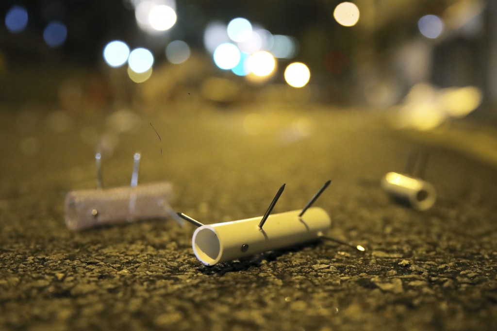 Nail roadblocks is placed on road by pro-democracy protesters outside the campus of the University of Hong Kong, early Thursday, Nov. 14, 2019. Univer...