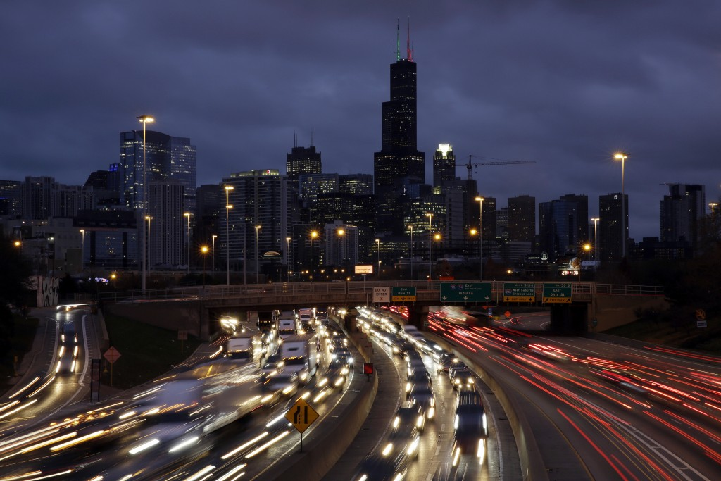 FILE - In this Nov. 21, 2018, file photo taken with a long exposure, traffic streaks across the John F. Kennedy Expressway at the start of the Thanksg...