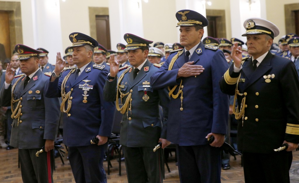 Bolivia's new Commander in Chief of the Armed Forces, Gen. Carlos Sergio Orellana Centellas, from left, Chief of Staff of the Command, Gen. Pablo Guer...