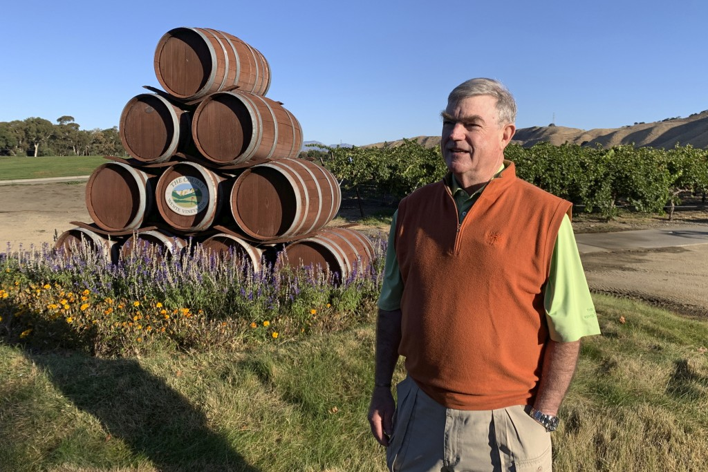 In this Oct. 4, 2019 photo, Eric Wente, chairman of Wente Vineyards, stands near vineyards at his family-run winery, which was founded by his great gr...