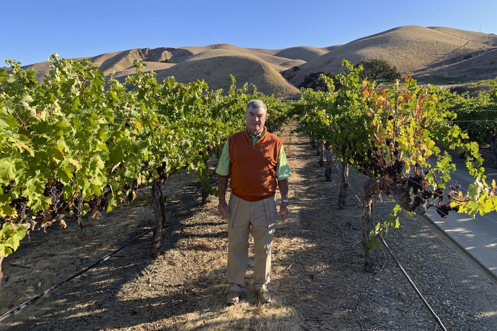 In this Oct. 4, 2019 photo, Eric Wente, chairman of Wente Vineyards, stands in vineyards at his family-run winery, which was founded by his great gran...