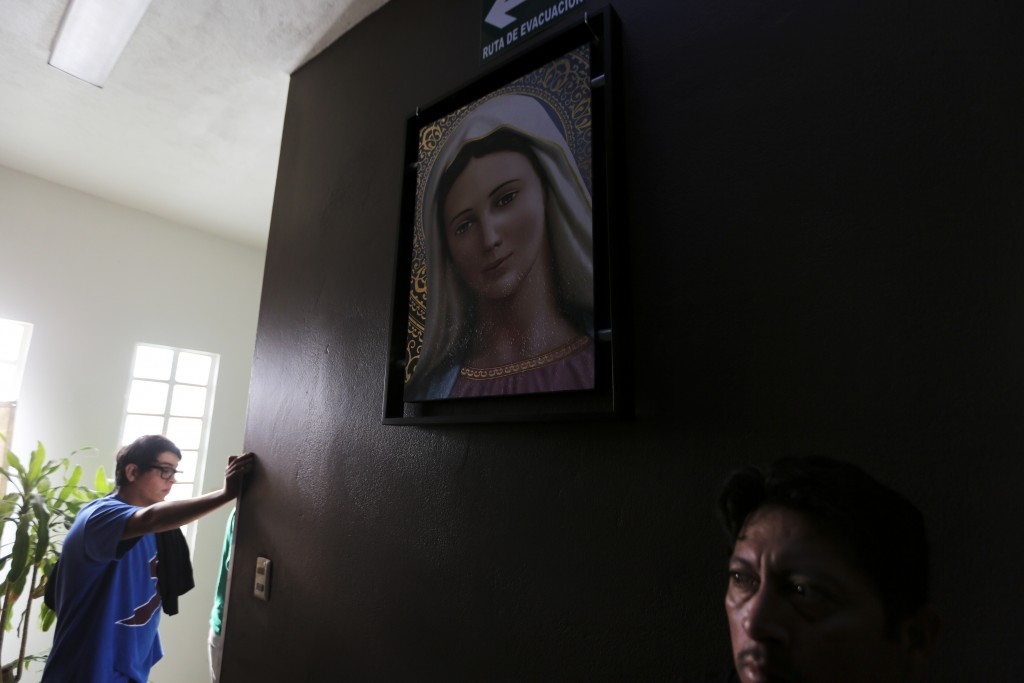 ADVANCE FOR USE SUNDAY, NOV. 17, 2019 AND THEREAFTER- In this Oct. 10, 2019 photo, Mexican migrants wait to make a flight reservation with the help of...