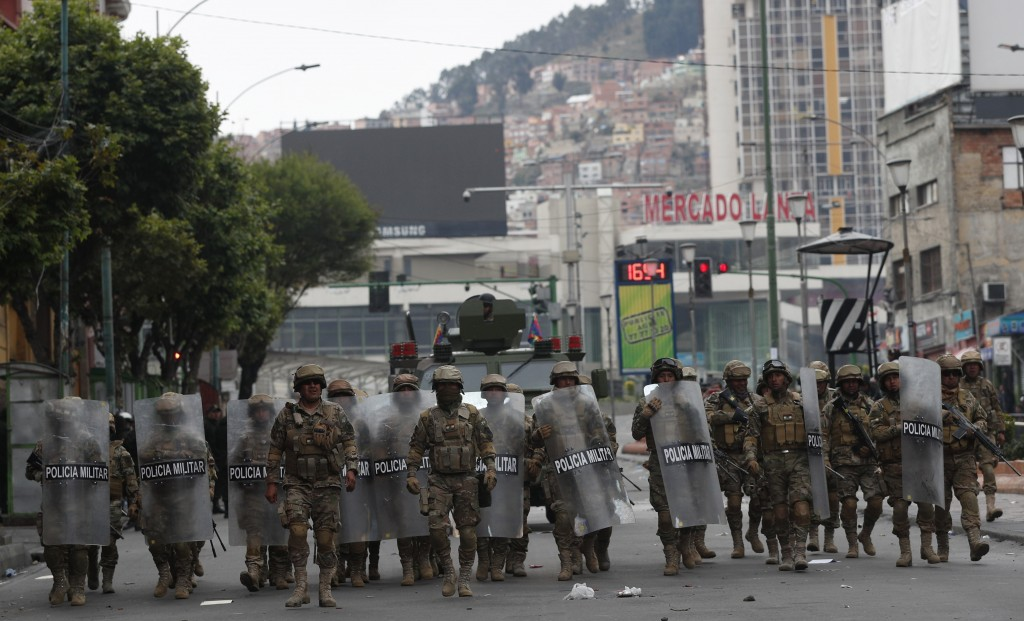 Military Police patrol in La Paz, Bolivia, Wednesday, Nov. 13, 2019. Bolivia's new interim president faces the challenge of stabilizing the nation and...