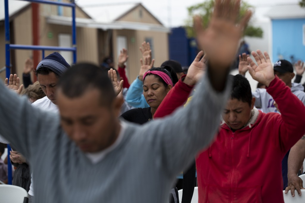 ADVANCE FOR USE SUNDAY, NOV. 17, 2019 AND THEREAFTER- In this Oct. 12, 2019 photo, Cubans pray at a migrant shelter in Reynosa, Mexico. In years past,...