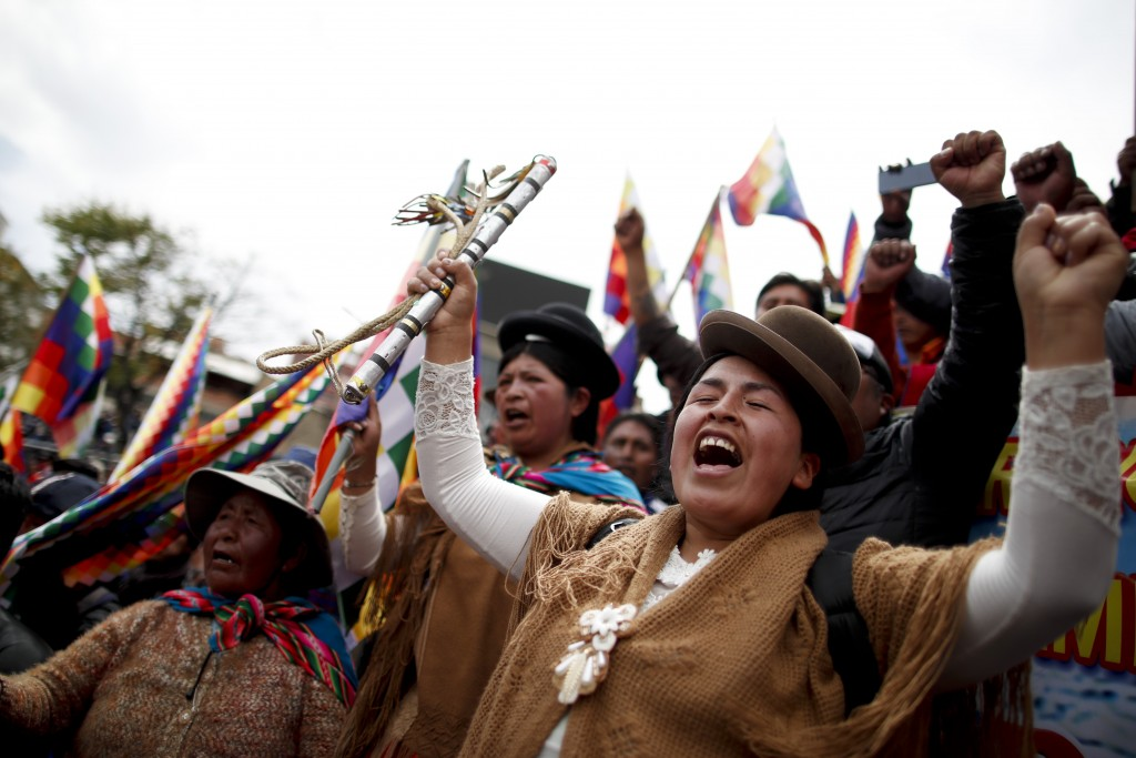 Backers of former President Evo Morales march in La Paz, Bolivia, Wednesday, Nov. 13, 2019. Bolivia's new interim president Jeanine Anez faces the cha...