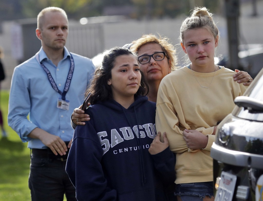 People wait outside of Saugus High School after reports of a shooting on Thursday, Nov. 14, 2019, in Santa Clarita, Calif.  Los Angeles County Sheriff...