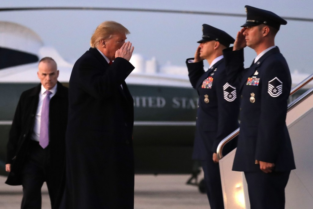 President Donald Trump boards Air Force One for a campaign rally in Bossier City, La., Thursday, Nov. 14, 2019, at Andrews Air Force Base, Md. (AP Pho...